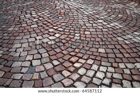 Background texture of granite cobblestone road - stock photo