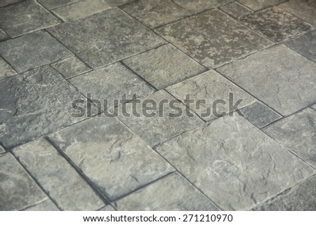 Background texture of gray tiled pavement city ground. - stock photo
