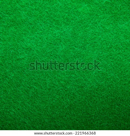 Background texture of green felt casino table in closeup - stock photo