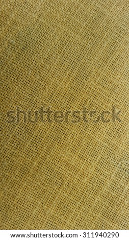 Background texture of hessian or burlap showing the coarse weave of the natural fibers - stock photo
