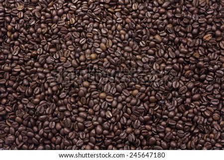 Background texture of mixed roasted coffee beans  - stock photo