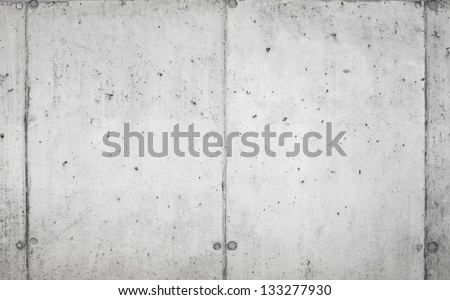 Background texture of modern concrete wall made of blocks - stock photo