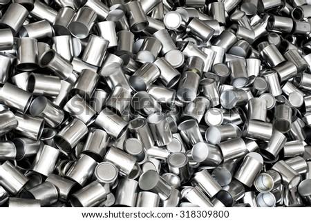 Background texture of new empty tins for canning food products viewed from overhead in a full frame view, nutrition concept - stock photo