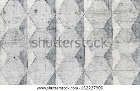Background texture of old gray concrete fence with square pattern - stock photo