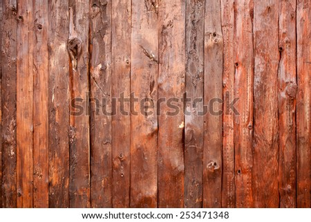 Background texture of old red rough wooden wall - stock photo