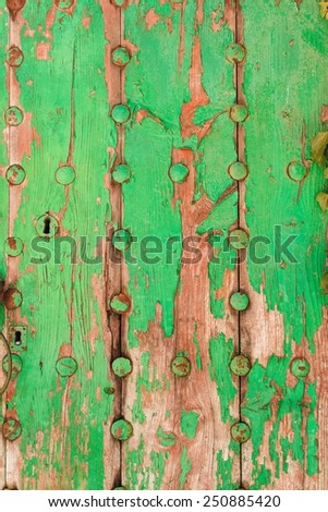 Background texture of old rustic weathered grunge cracked wood with a metallic buttons. Green vintage surface. Top view.  - stock photo