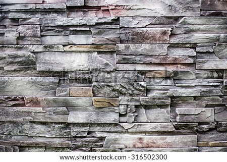background texture of pattern present rock wall for decorated home to make your house relax and beautiful - stock photo