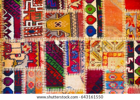 Background texture of pieces of old carpets with stitching thick threads