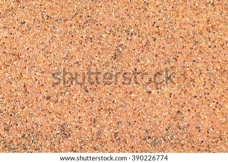 Background texture of polished stone showing the random distribution of constituent minerals forming a speckled pattern