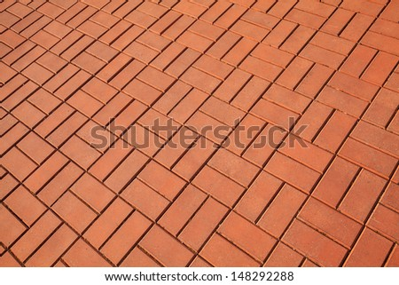 Background texture of red cobblestone pavement