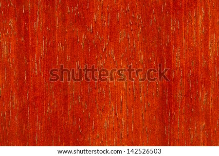 Background texture of red wood closeup