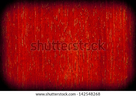 Background texture of red wood closeup with vignette