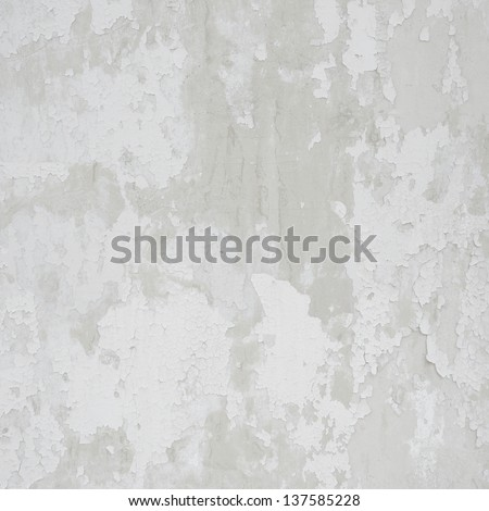 Background texture of the old cracked wall with peeling paint and plaster - stock photo