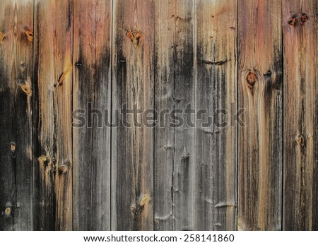 Background, texture. Old, worn, wooden fence - stock photo