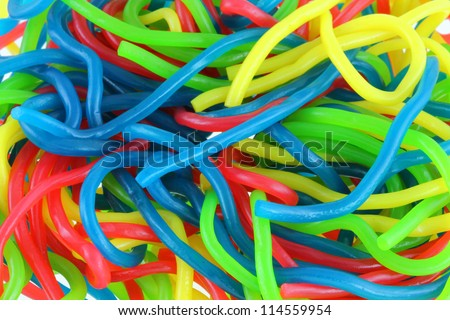 Background texture photo of Assortment of colorful fruity Gummy Spaghetti