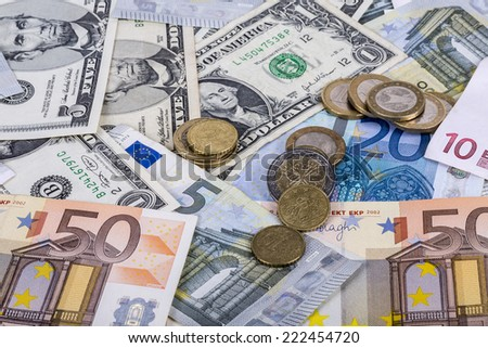 background textures with banknotes and euro coins and dollar - stock photo