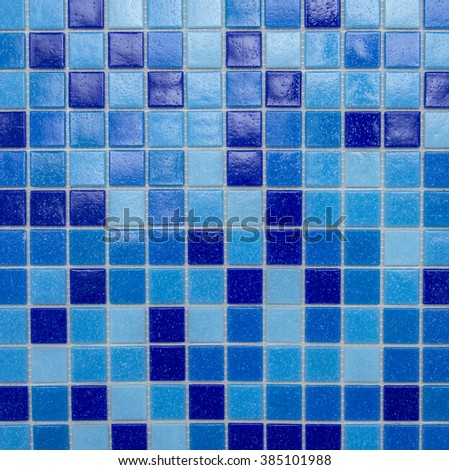 Background tiles in a mosaic of blue.