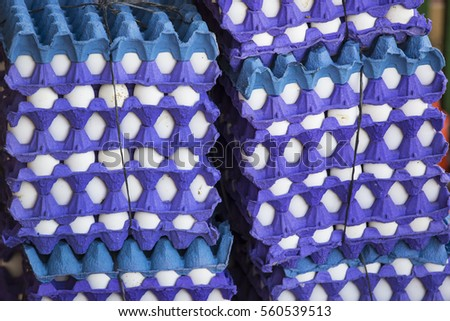 Background tray with fresh eggs on the market