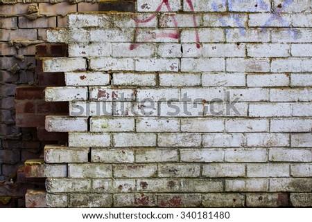 Background/ wallpaper - decayed/ damaged brick wall. - stock photo