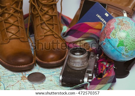 background - what to take for a trip. passport, phone, documents, map, camera, globe, handbag, boots, accessories