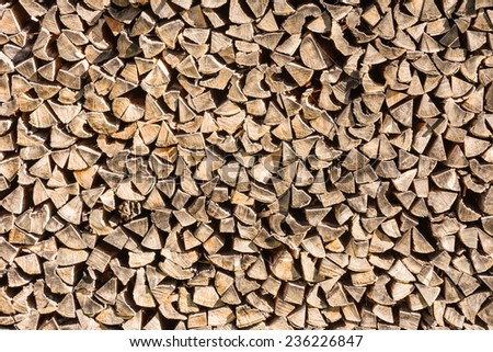 Background with a pile of firewood
