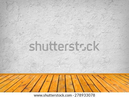 Background with an empty grey dirty wall and wooden floor below with large copy space for your text  - stock photo