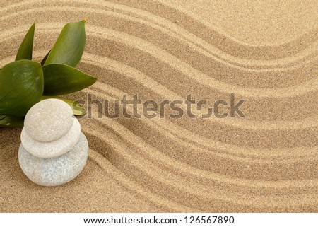 background with balance zen stones in sand and green leaves - stock photo