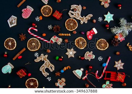 Background with balls, Christmas cookies, snowflakes and oranges. Christmas pattern.