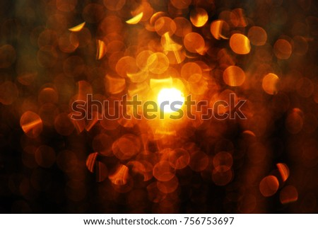 Background with bokeh and sun flare on the glass in the evening light