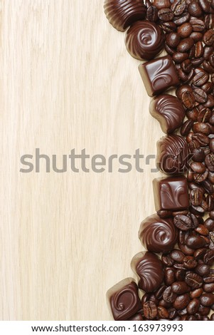Background with chocolate candy and coffee beans