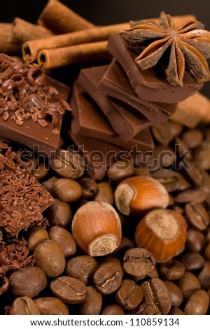 background with chocolate , coffee, spices and nuts
