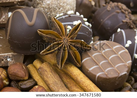background with chocolate, coffee, spices and nuts
