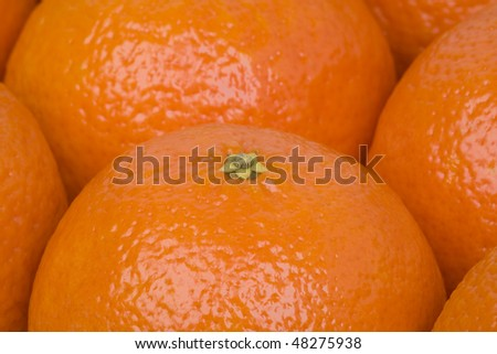 Background with close up of tangerines.