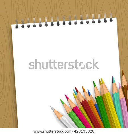 Background with color pencils. Empty notebook with color pencil on the table - stock photo