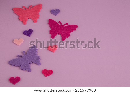 background with colorful butterflies and hearts on purple - stock photo