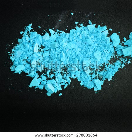 Background with colorful powder. Crushed eyeshadow on black background. Abstract background. Selective focus. - stock photo