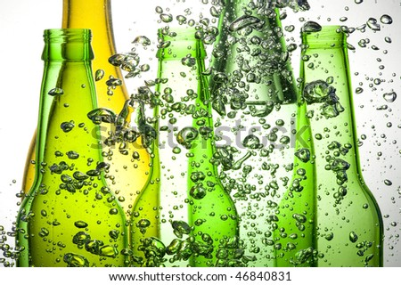 Background with colour bottle and bubbles water - stock photo