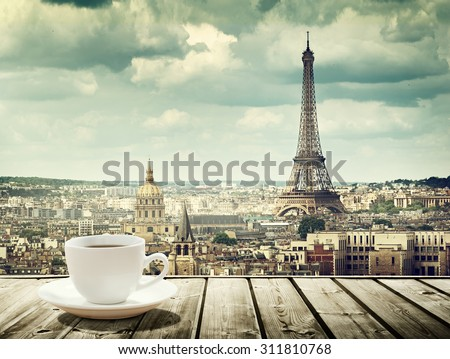 background with cup of coffee and Eiffel tower in Paris - stock photo