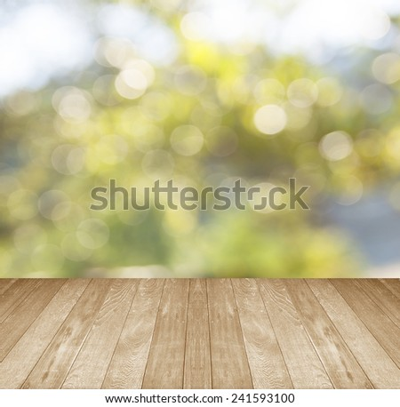 background with empty wooden deck table over winter bokeh blur - stock photo