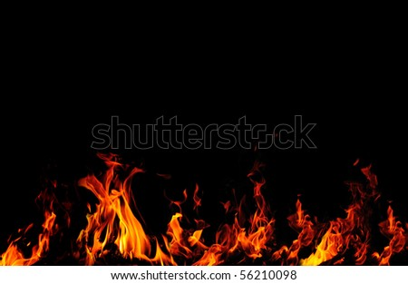 Background with fire flames isolated on black - stock photo