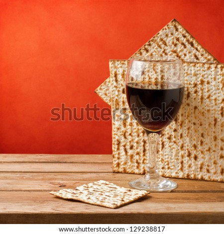 Background with glass of wine and matzo for passover celebration