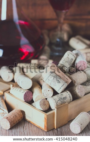 Background with glass of wine, decanter and wine corks. Wine concept - stock photo