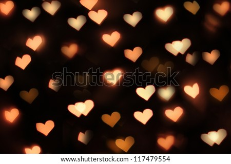 Background with glowing hearts - stock photo