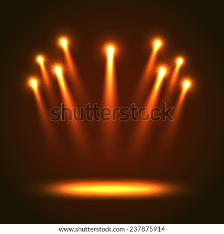 Background With Group Bright Projectors. Orange colored lights - stock photo