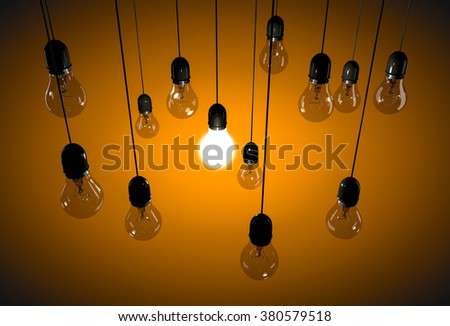 Background with hanging incandescent bulbs on black cables - stock photo