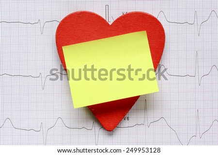 Background with heart symbol. Cardiogram background with heart symbol and note - stock photo