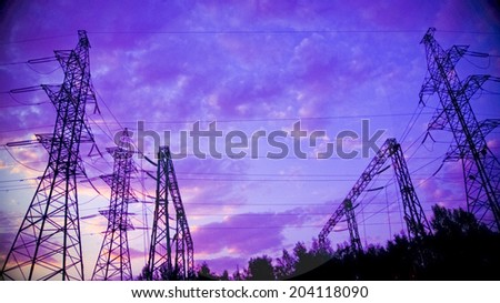 Background with high voltage tower on a sunrise - stock photo