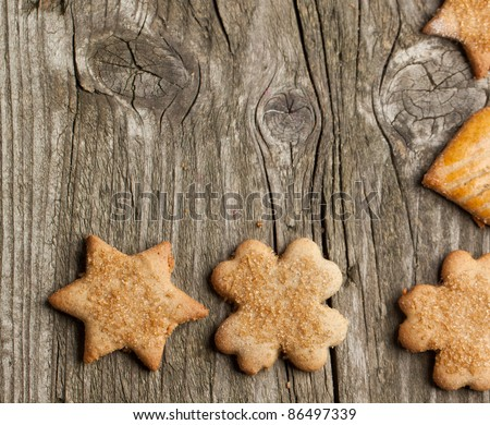 Background with homemade sugar cookies on old wooden table
