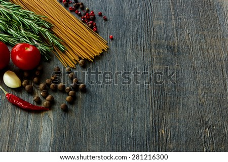 Background with Italian ingredients for cooking over dark wooden board (with easy removable sample text). - stock photo