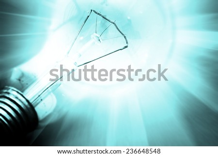 Background with lit lightbulb. Modern look. - stock photo